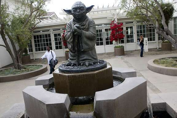 A statue of Yoda in the courtyard of Lucas films Light & Magic in the Presidio in San Francisco, Calif., as employees do their business on Tuesday, October 30, 2012.