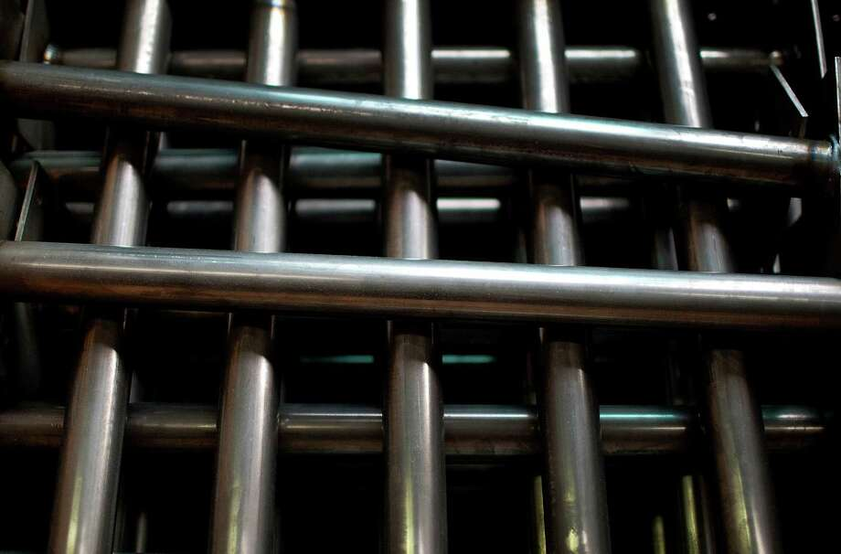 Steel tubes wait to be assembled into bicycle frames. Revenue at United States Steel Corp. declined 8 percent in the third quarter, the company said. Photo: Scott Eells, 1008833