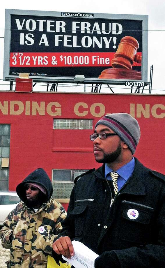 """Mike Wilder, director of the African American Round Table, wants Clear Channel to take down billboards in the central city of Milwaukee that warns about voter fraud. He says the billboards """"confuse and discourage"""" minority voters. Photo: Georgia Pabst"""