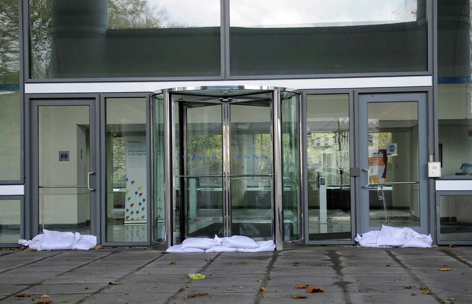 Sandbags sit at the door to Pitney Bowes on Tuesday, October 30, 2012. Photo: Lindsay Niegelberg