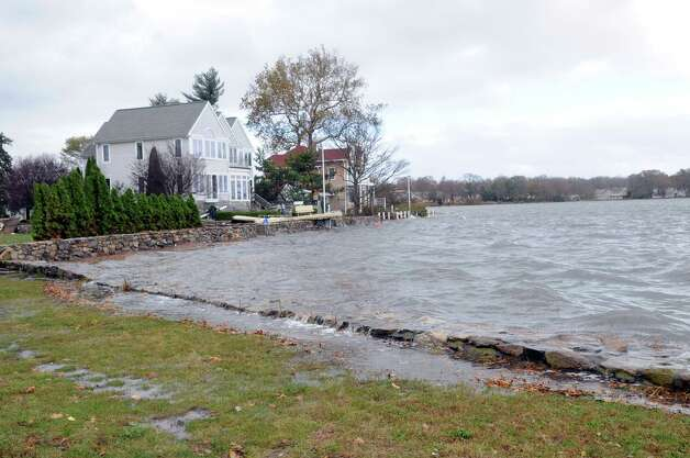 High water levels send waves over the wall on Weed Avenue in Stamford on Tuesday, October 30, 2012. Photo: Lindsay Niegelberg