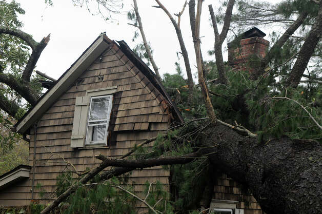 A tree crushed the gatehouse at the Bartlett Arboretum on Brookdale Road which served as a home to newlyweds Brad and Alexandra Nagle after weather from Hurricane Sandy in Stamford, Conn., Oct. 30, 2012. The Nagles were married three weeks ago, their wedding gifts, which included family heirlooms, are still in the house. Photo: Keelin Daly