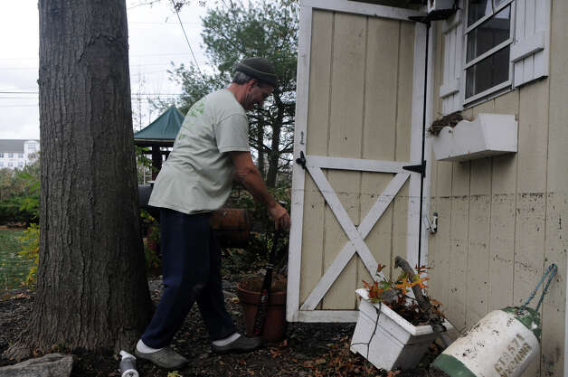 Chris Gerbert assesses the water line left on his Davenport Drive shed after an unusually high tide along with weather from Hurricane Sandy related weather caused unprecedented flooding to the homes and neighborhood in the West side of Stamford, Conn., Oct. 30, 2012. Photo: Keelin Daly