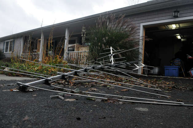 The television antenna lays in the driveway of Justin Colombo's Davenport Drive after high winds from Hurricane Sandy related weather blew it off of his home in Stamford, Conn., Oct. 30, 2012. Photo: Keelin Daly