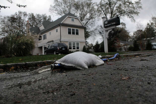 An unusually high tide along with Hurricane Sandy related weather caused unprecedented flooding to the homes and neighborhood of Davenport Drive in the West side of Stamford, Conn., Oct. 30, 2012. Photo: Keelin Daly
