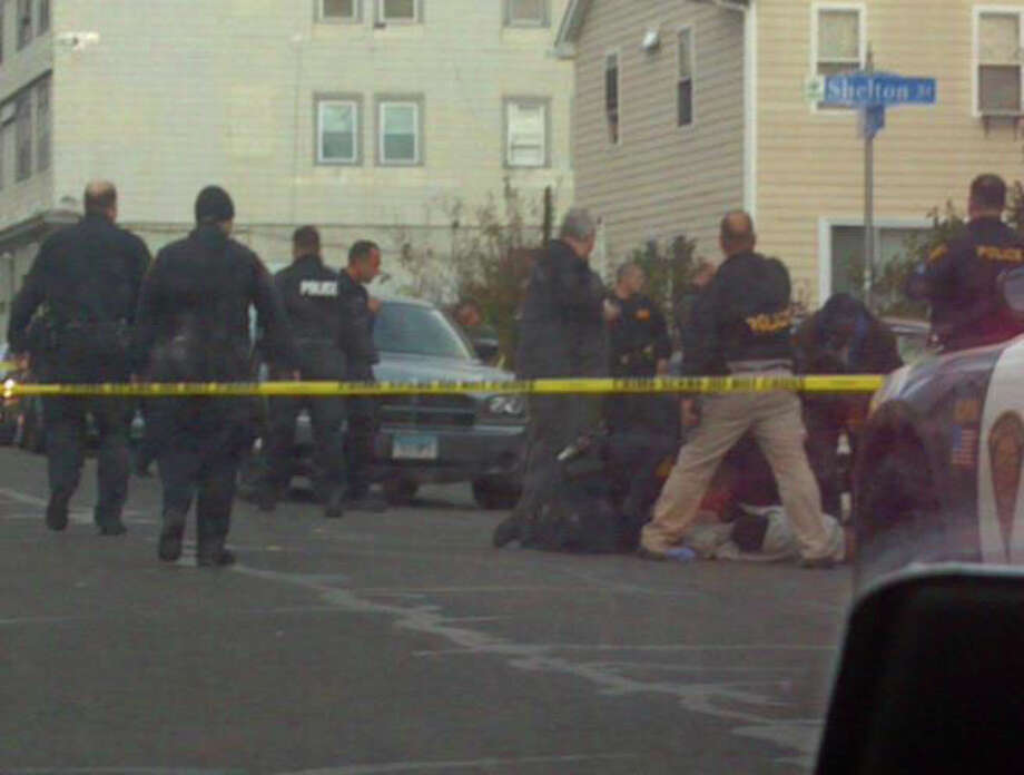 Bridgeport police make an arrest in the city's East Side after a man was shot there Tuesday, Oct. 30, 2012. Four men were charged with the unidentified man's murder, police said. Photo: Contributed Photo