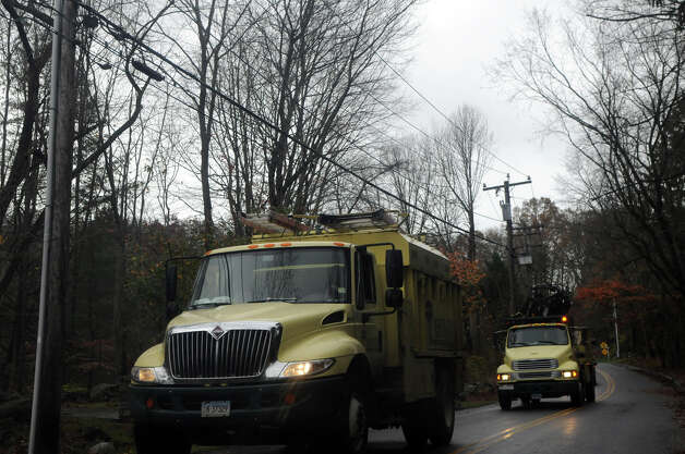 A Bartlett Tree crew passes along Hunting Ridge Road after Hurricane Sandy related weather in Stamford, Conn., Oct. 30, 2012. Photo: Keelin Daly
