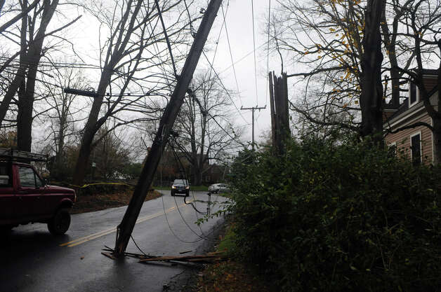 Drivers pass under hanging wires along Davenport Ridge Road after Hurricane Sandy related weather hit Stamford, Conn., Oct. 30, 2012. Photo: Keelin Daly
