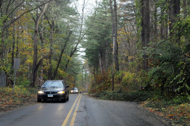 Power lines and tree limbs line Lakeside Drive after Hurricane Sandy related weather in Stamford, Conn., Oct. 30, 2012. Photo: Keelin Daly