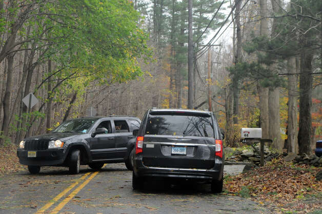 Power lines and tree limbs line North Stamford Road after Hurricane Sandy related weather in Stamford, Conn., Oct. 30, 2012. Photo: Keelin Daly