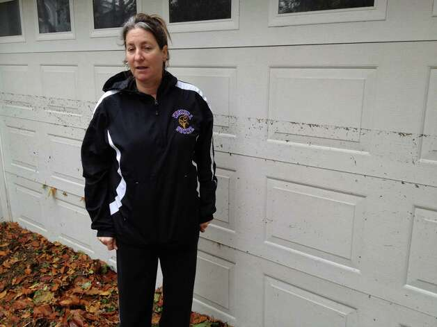 Weed Circle resident Andree Kaminsky points out how high the water came up the garage doors on her Holly Pond home in Stamford, Conn. on Tuesday, Oct. 30, 2012. Photo: John Nickerson