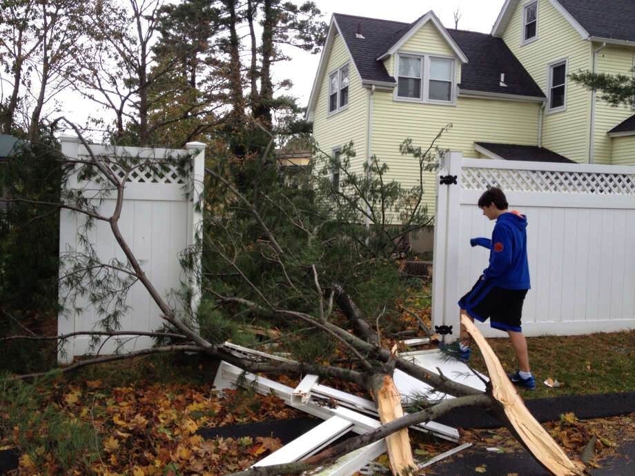 This is how we found our house on Forrest Ave. in Greenwich this morning after evacuating yesterday before the storm. Our son, Ryan Lieberman surveys the damage.  (Rich)