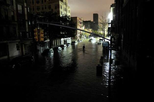 A general view of submerged cars on Ave. C and 7th st, after severe flooding caused by Hurricane Sandy, on October 30, 2012 in Manhattan, New York. The storm has claimed at least 16 lives in the United States, and has caused massive flooding across much of the Atlantic seaboard. US President Barack Obama has declared the situation a 'major disaster' for large areas of the US East Coast including New York City, with wide spread power outages and significant flooding in parts of the city. Photo: Christos Pathiakis, Getty Images / 2012 Getty Images