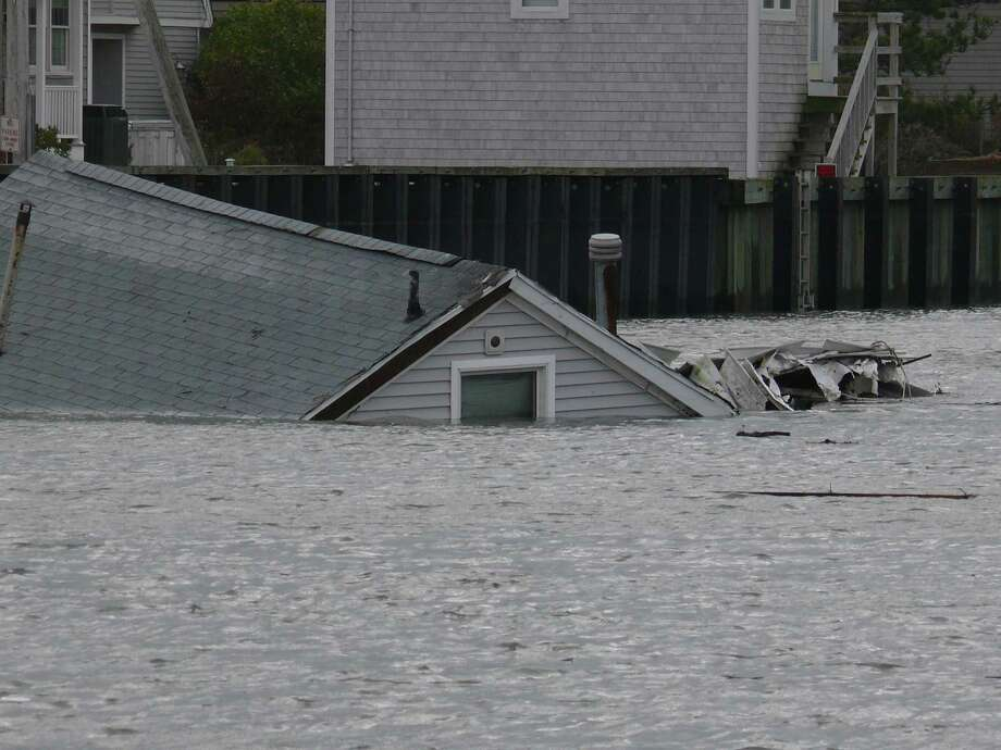 House floats off Fairfield Beach Road in the wake of Hurricane Sandy on Tuesday. Photo: Genevieve Reilly