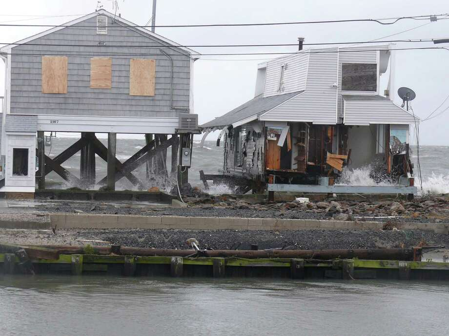 Damaged homes on Fairfield Beach Road. Photo: Genevieve Reilly