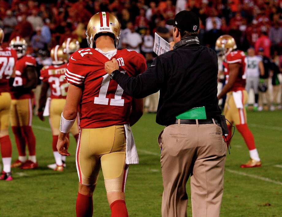 49ers coach Jim Harbaugh grabbed Alex Smith's jersey as he sent him back out in the fourth quarter. The San Francisco 49ers beat the Seattle Seahawks 13-6 in San Francisco, Calif at Candlestick Park, Photo: Brant Ward, The Chronicle / ONLINE_YES