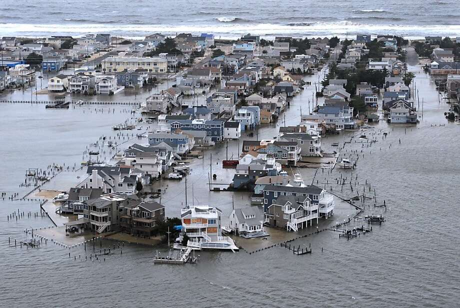 A Portion of Harvey Cedars on Long Beach Island, New Jersey is underwater Tuesday, Oct. 30, 2012, a day after Hurricane Sandy blew across the New Jersey barrier islands. (AP Photo/The Philadelphia Inquirer, Clem Murray) Photo: Clem Murray, Associated Press