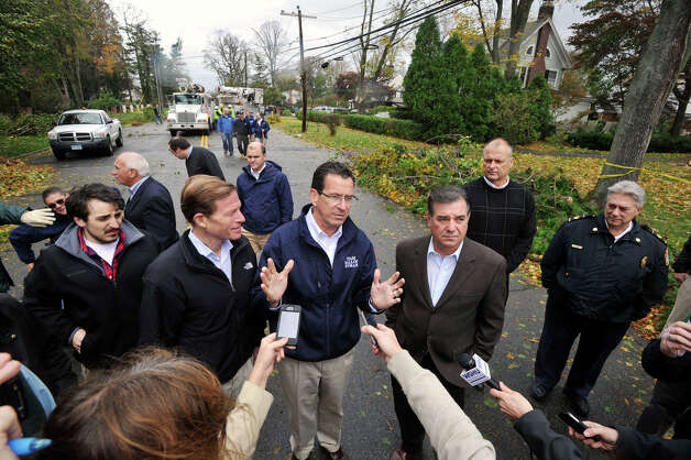 Gov. Dannel P. Malloy addresses the media while touring damage along Shippan Avenue in Stamford, Conn., caused by the effects of Hurricane Sandy on Tuesday, Oct. 30, 2012. To the left of Malloy is U.S. Sen. Richard Blumenthal and to the right is Stamford Mayor Michael Pavia. Photo: Jason Rearick