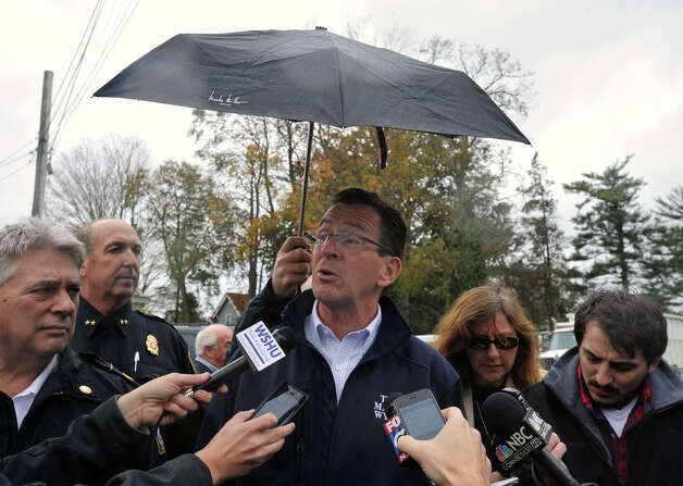 Gov. Dannel P. Malloy addresses the media while touring damage along Shippan Avenue in Stamford, Conn., caused by the effects of Hurricane Sandy on Tuesday, Oct. 30, 2012. To the far left is Stamford Fire Chief Anthony Conte and Police Chief Jon Fontneau. Photo: Jason Rearick