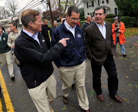 From left, U.S. Sen. Richard Blumenthal, Gov. Dannel P. Malloy and Stamford Mayor Michael Pavia tour the damage along Shippan Avenue in Stamford, Conn., caused by the effects of Hurricane Sandy on Tuesday, Oct. 30, 2012. Photo: Jason Rearick