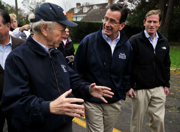 From left, U.S. Sen. Joseph Lieberman, Gov. Dannel P. Malloy and U.S. Sen. Richard Blumenthal tour the damage along Shippan Avenue in Stamford, Conn., caused by the effects of Hurricane Sandy on Tuesday, Oct. 30, 2012. Photo: Jason Rearick