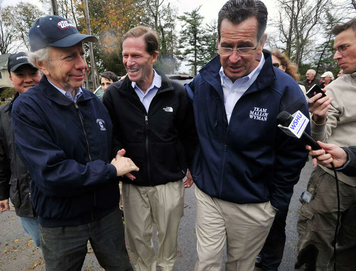 From left, U.S. Sens. Joseph Lieberman and Richard Blumenthal and Gov. Dannel P. Malloy tour the dam
