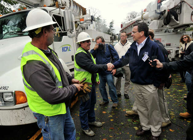 Gov. Dannel P. Malloy greets utility workers from Kansas City while touring the damage along Shippan Avenue in Stamford, Conn., caused by the effects of Hurricane Sandy on Tuesday, Oct. 30, 2012. Photo: Jason Rearick