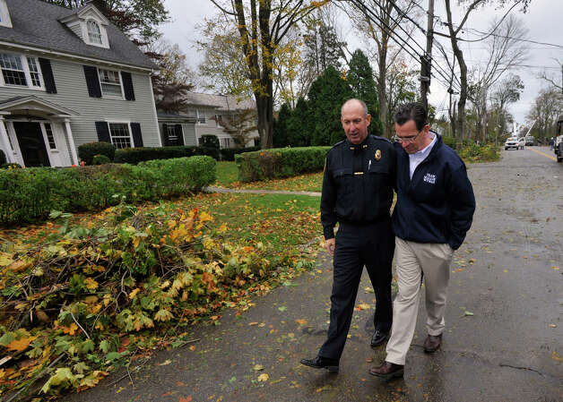 Stamford Police Chief Jon Fontneau, left, and Gov. Dannel P. Malloy tour the damage along Shippan Avenue in Stamford, Conn., caused by the effects of Hurricane Sandy on Tuesday, Oct. 30, 2012. Photo: Jason Rearick
