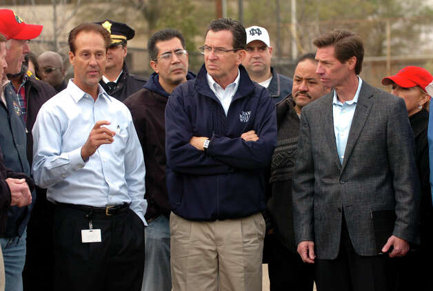 Governor Dannel P. Malloy, center, listens to United Illuminating Senior Vice President John Prete, left, during a tour of the Congress Street substation in the aftermath of Hurricane Sandy in Conn. on Tuesday October 30, 2012. At right is UI's CEO Jim Torgerson. Photo: Christian Abraham
