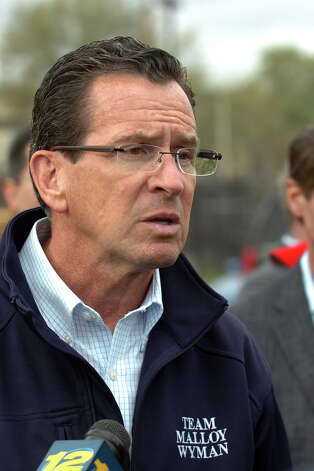 Governor Dannel P. Malloy speaks to the media gathered at the Congress Street United Illuminating substation in the aftermath of Hurricane Sandy in Bridgeport, Conn. on Tuesday October 30, 2012. Photo: Christian Abraham
