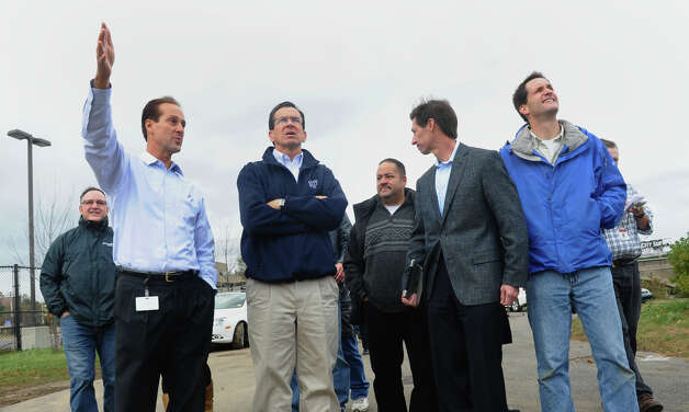 Governor Dannel P. Malloy, center, listens to United Illuminating Senior Vice President John Prete, left, during a tour of the Congress Street substation in the aftermath of Hurricane Sandy in Conn. on Tuesday October 30, 2012. Next to Gov. Malloy on the right is UI's CEO Jim Torgerson. Next to him is US Congressman Jim Himes. Photo: Christian Abraham