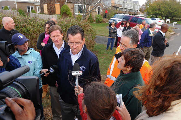 Governor Dannel P. Malloy stops to check out damage in the aftermath of Hurricane Sandy in East Haven, Conn. on Tuesday October 30, 2012. At right of Gov. Malloy is US Congresswoman Rosa DeLauro. Photo: Christian Abraham