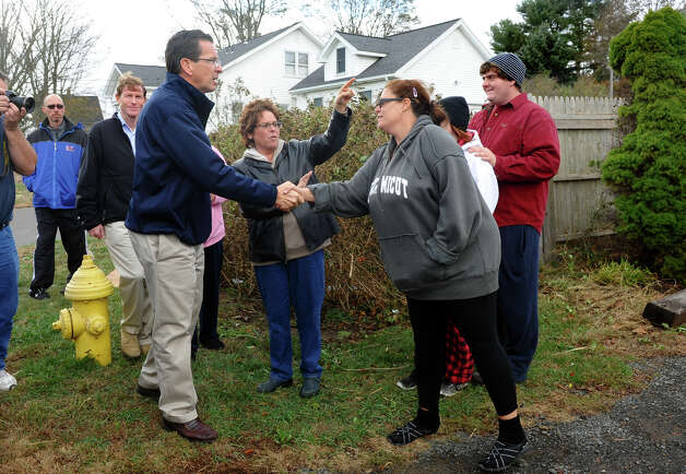 Governor Dannel P. Malloy greets resident Joann Andrews, as he stops to check out damage in the aftermath of Hurricane Sandy in East Haven, Conn. on Tuesday October 30, 2012. Photo: Christian Abraham