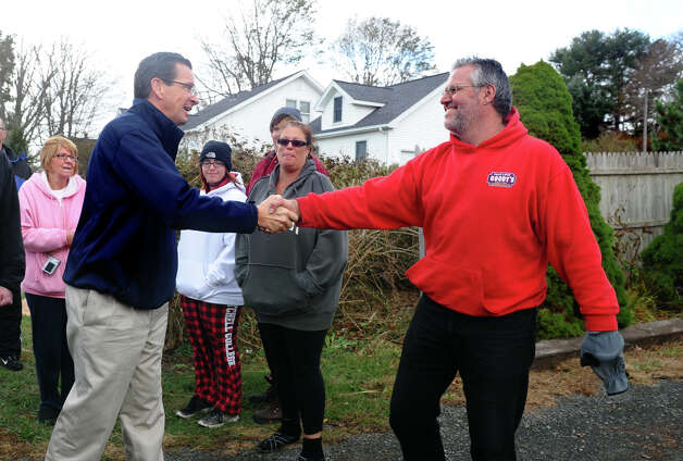 Governor Dannel P. Malloy greets resident Robert Andrews, as he stops to check out damage in the aftermath of Hurricane Sandy in East Haven, Conn. on Tuesday October 30, 2012. Photo: Christian Abraham