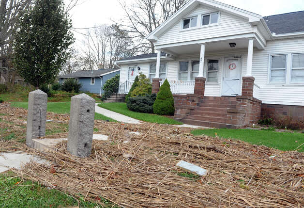 Debris from damage in the aftermath of Hurricane Sandy sits a quarter mile away from the sound along Silver Sands Road in East Haven, Conn. on Tuesday October 30, 2012. Photo: Christian Abraham
