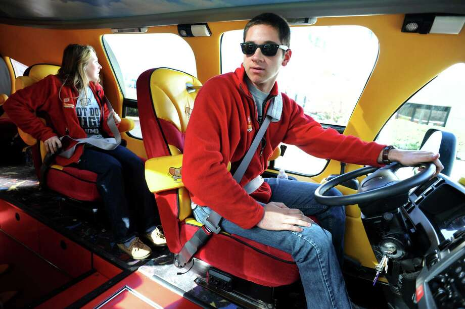 Hot doggers Theresa Brenner, 22, of Cincinnati, left, and Ben Urkov, 23, of Chicago are partners in their Wienermobile travels on Tuesday, Oct. 30, 2012, in Colonie, N.Y. (Cindy Schultz / Times Union) Photo: Cindy Schultz /  00019871A