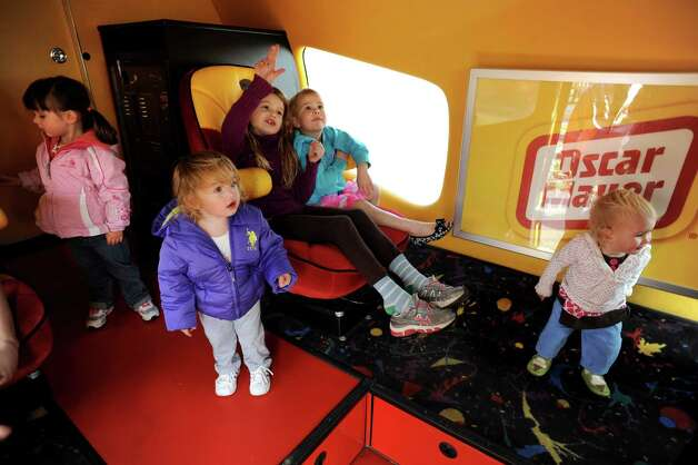 Children settle inside the Wienermobile on Tuesday, Oct. 30, 2012, at The Crossings in Colonie, N.Y. (Cindy Schultz / Times Union) Photo: Cindy Schultz /  00019871A