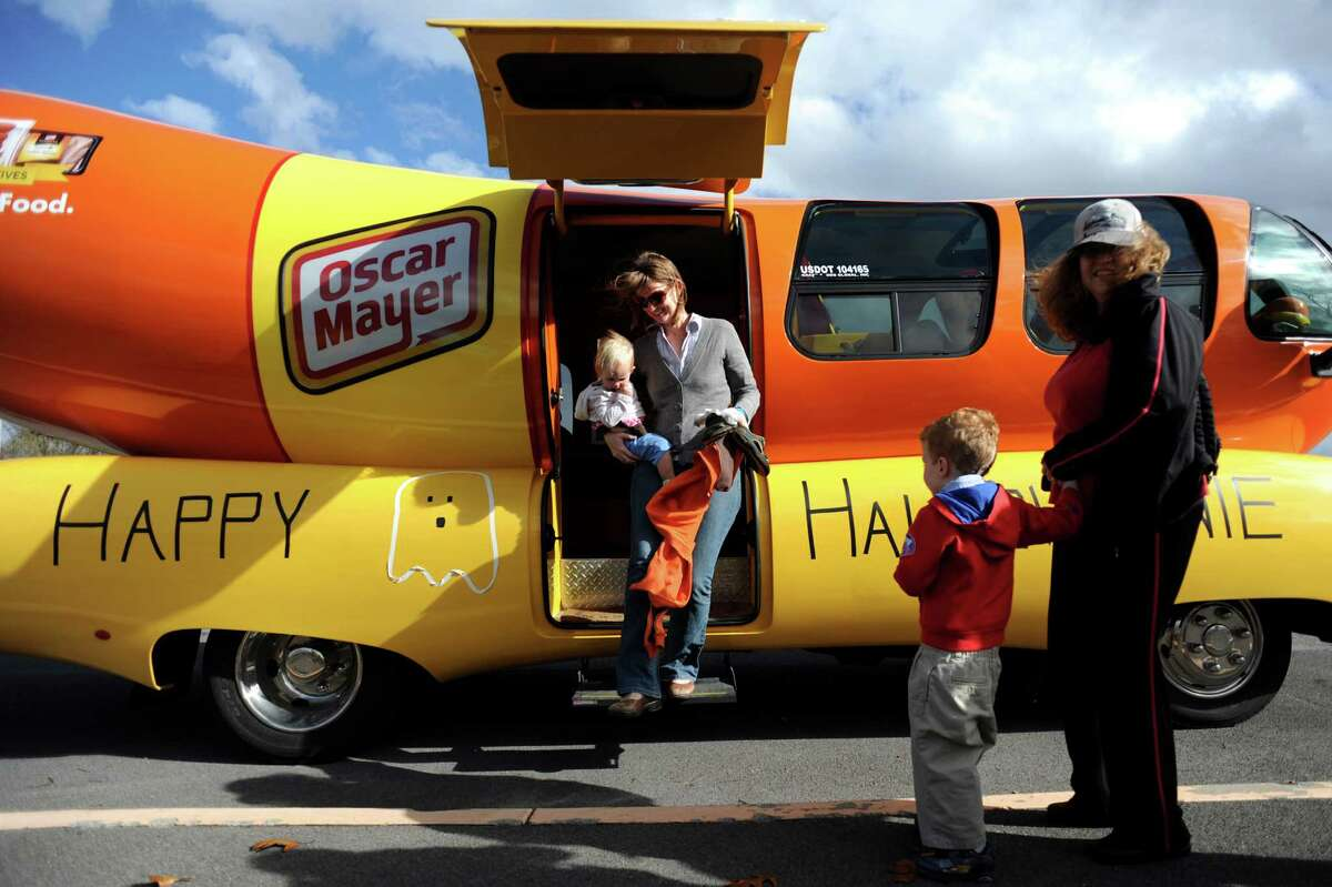 Jennifer Lamont of Albany, center, carries her daughter Tilly, 1, from inside the Wienermobile on Tuesday, Oct. 30, 2012, at The Crossings in Colonie, N.Y. (Cindy Schultz / Times Union)
