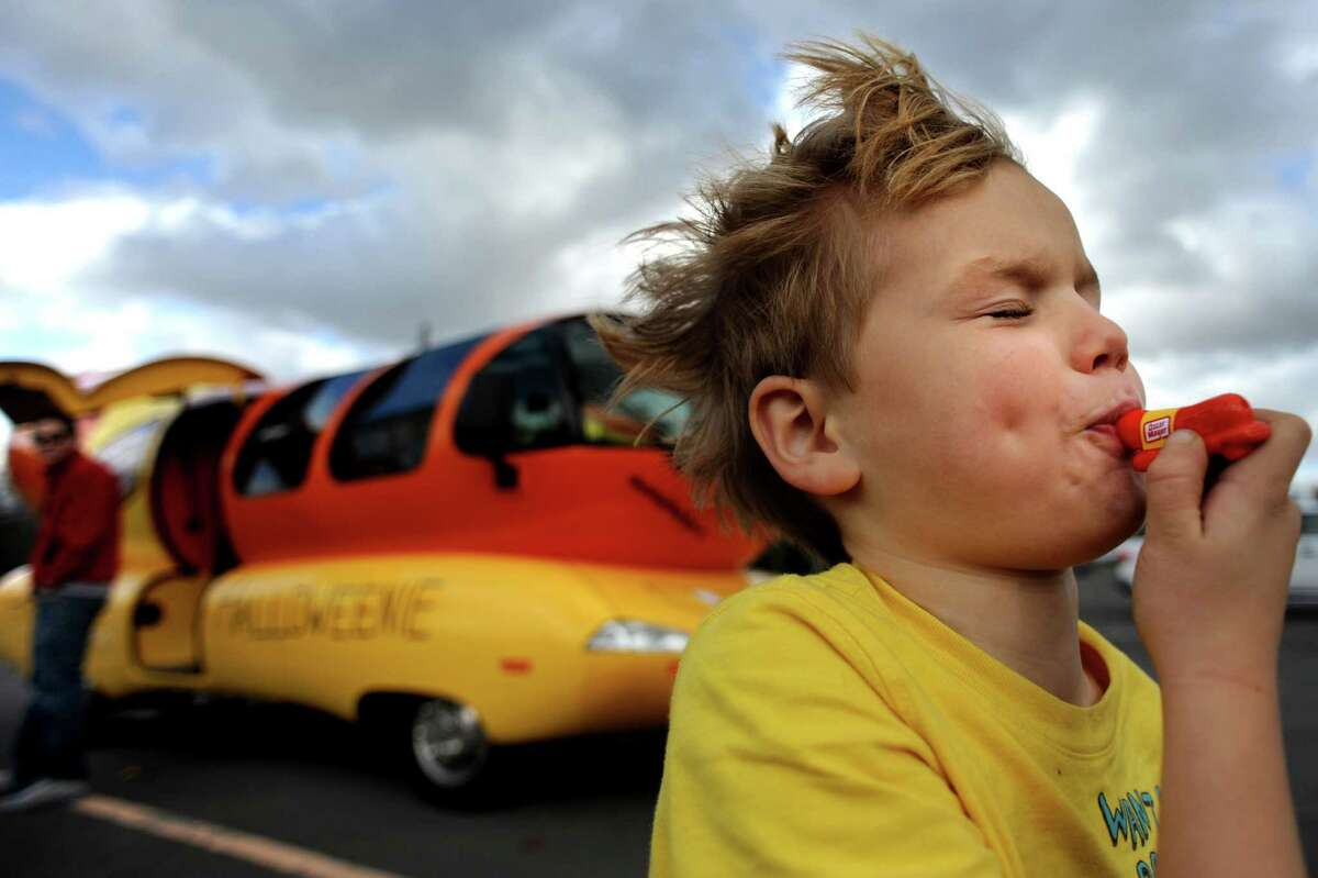 John Lamont, 6, of Albany blows his wiener whistle after visiting the Wienermobile on Tuesday, Oct. 30, 2012, at The Crossings in Colonie, N.Y. (Cindy Schultz / Times Union)