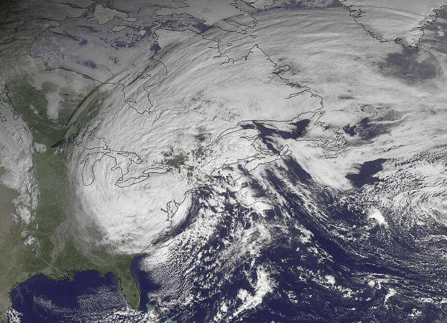 This NOAA satellite image taken Tuesday, Oct. 30, 2012, shows superstorm Sandy slowly moving westward while weakening across southern Pennsylvania. The National Weather Service said a foot and more of snow was reported in lower elevations of West Virginia, where most towns and roads are. High elevations in the mountains were getting more than two feet and a blizzard warning for more than a dozen counties was in effect until Wednesday afternoon. (AP Photo/NOAA) Photo: HOPD / NOAA