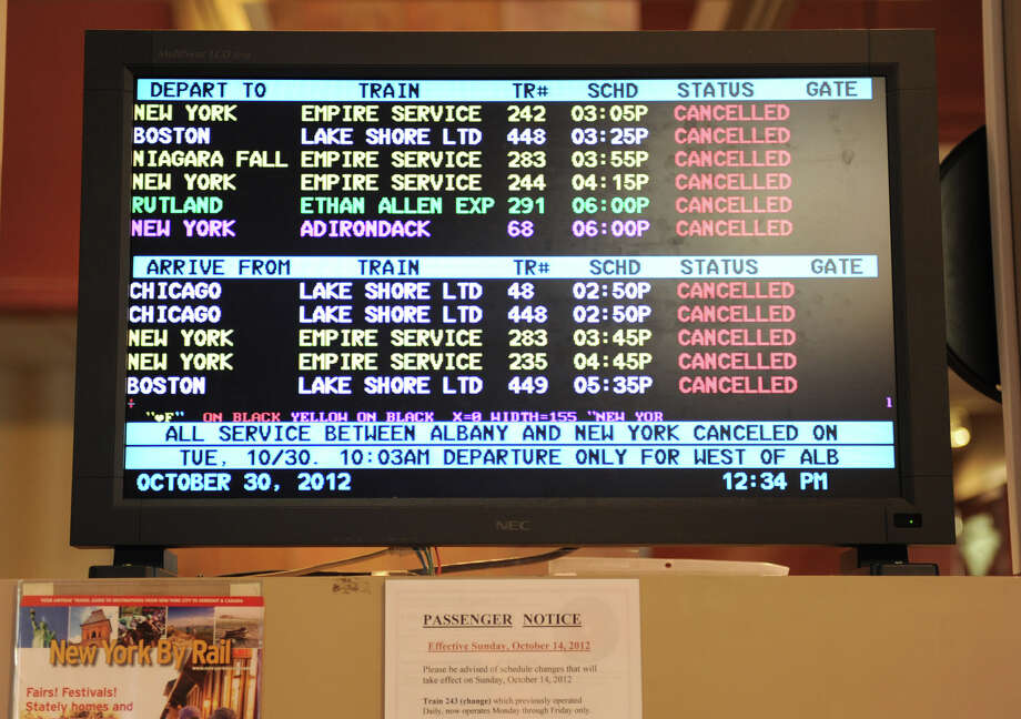 A screen displaying cancellations for all trains  at headed to NYC at the Albany-Rensselaer Train Station on Tuesday, Oct. 30, 2012 in Rensselaer, N.Y. (Lori Van Buren / Times Union) Photo: Lori Van Buren