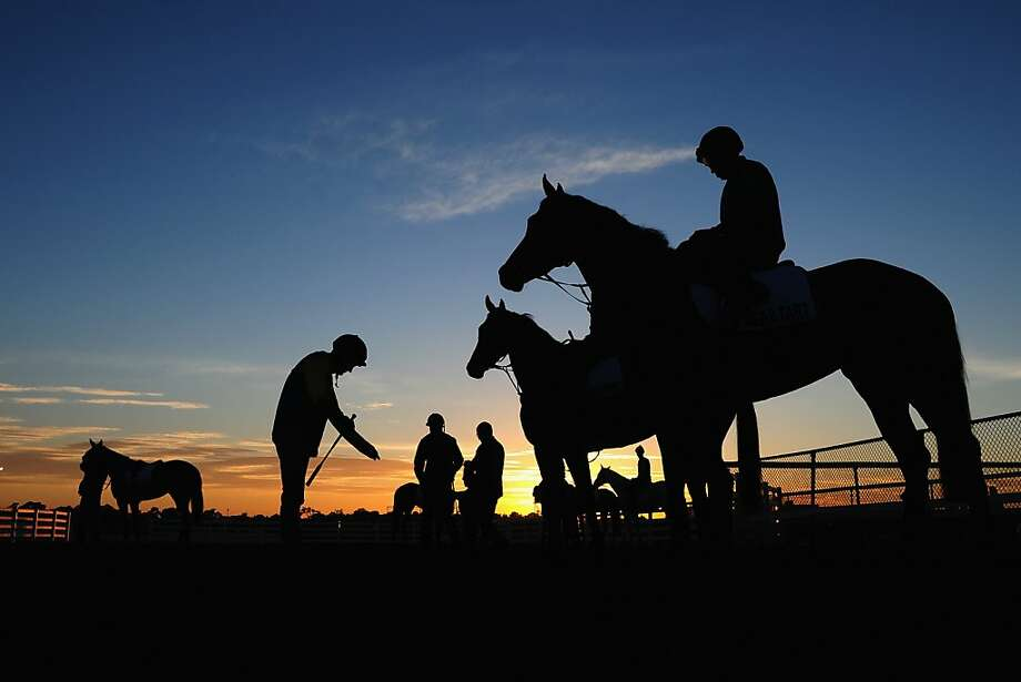 Jockey Mark Zahra (standing) prepares to head out to trackwork at Flemington Racecourse on October 30, 2012 in Melbourne, Australia.  (Photo by Vince Caligiuri/Getty Images) Photo: Vince Caligiuri, Getty Images