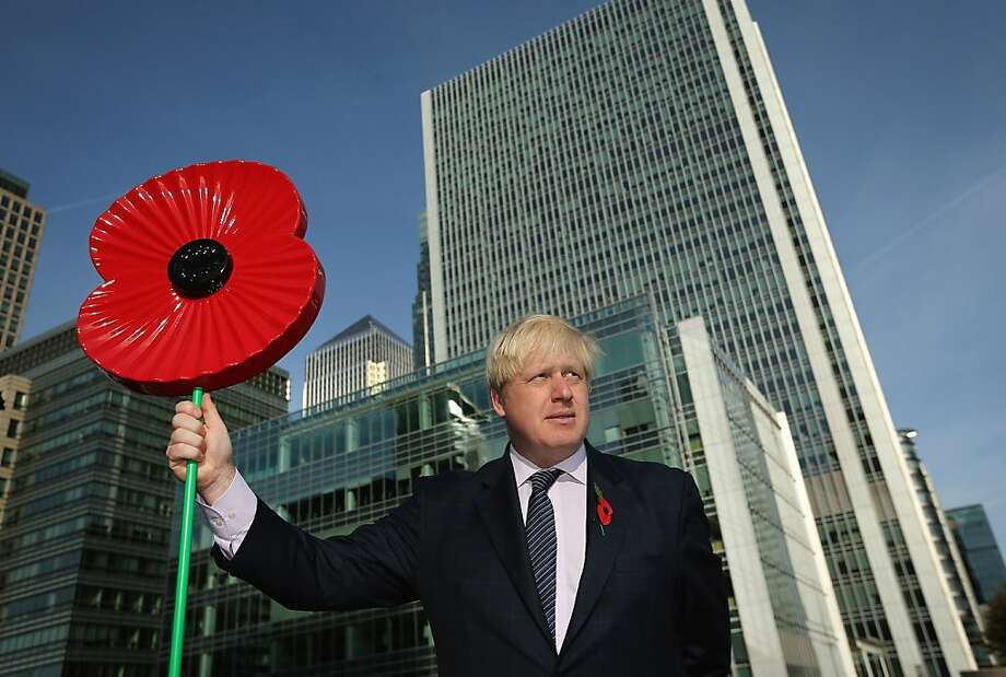 Mayor of London Boris Johnson holds a giant Poppy during a photocall after being winched on board HMS Severn on October 30, 2012 in London, England.  Mr Johnson was taking part in the event to raise awareness of the Royal British Legion's Poppy Day appeal. This year will be the first time that customers can pay for a poppy using contactless technology on their credit cards. The money raised from the sale of the poppy badges will go towards the Royal British Legion's fund to support the armed forces.  (Photo by Dan Kitwood/Getty Images) Photo: Dan Kitwood, Getty Images