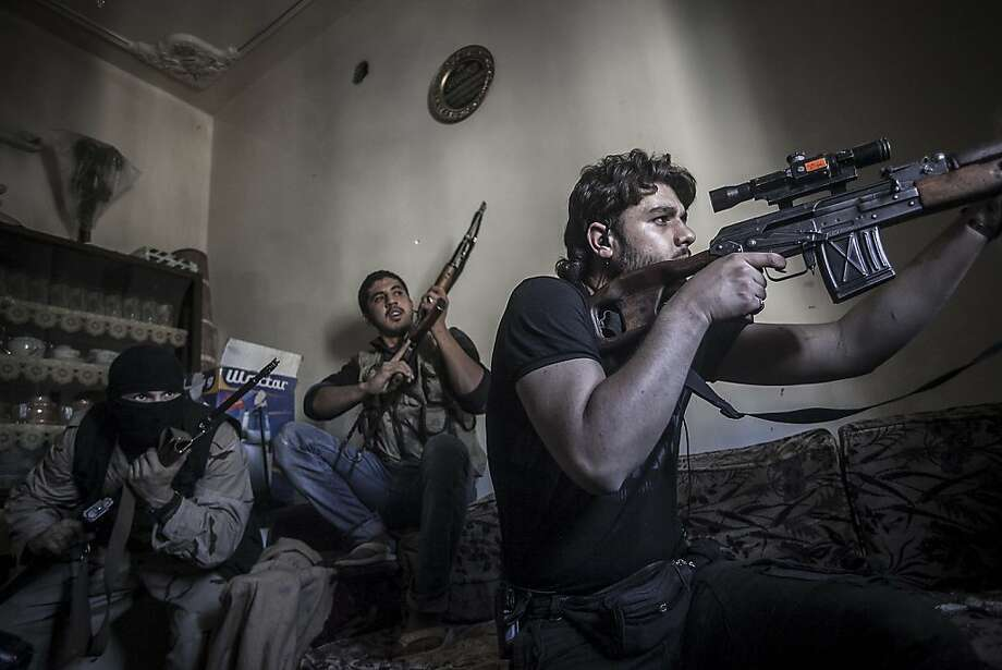 In this Monday, Oct. 29, 2012 photo, a rebel sniper aims at Syrian army positions in the Aleppo Jedida district, Syria. Syrian fighter jets pounded rebel areas across the country on Monday with scores of airstrikes that anti-regime activists called the most widespread bombing in a single day since Syria's troubles started 19 months ago. (AP Photo/Narciso Contreras). Photo: Narciso Contreras, Associated Press