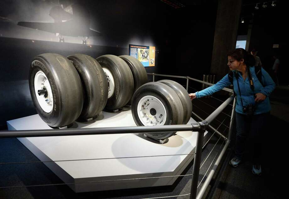 A woman touches the tires of space shuttle Endeavour after the grand opening ceremony of the exhibit at the new Samuel Oschin Pavilion of the California Science Center on October 30, 2012 in Los Angeles, California. Photo: Kevork Djansezian, Getty Images / 2012 Getty Images