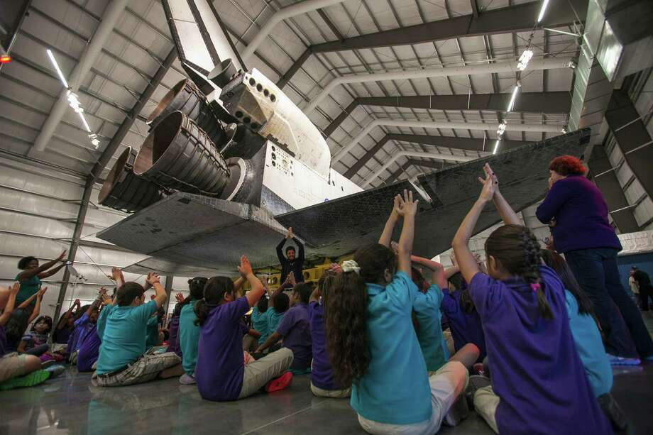 School children attend the opening of the  Space Shuttle Endeavour at the Oschin Pavilion at the California Science Center in Los Angeles Tuesday, Oct. 30, 2012. Photo: Damian Dovarganes, Associated Press / AP