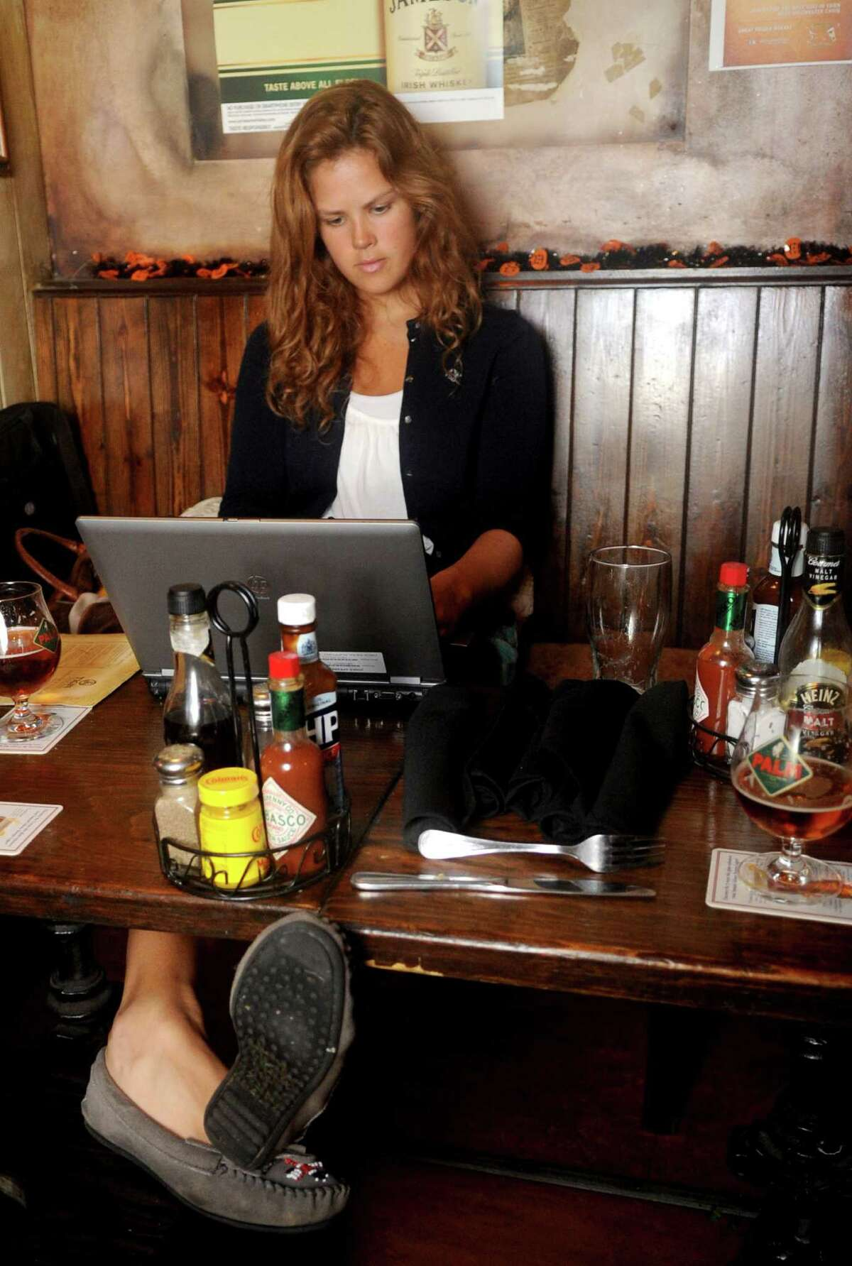Gillian Stewart, a New York City resident who came to stay with family in Stamford, Conn., before Hurricane Sandy, works remotely from Tigin because she is without electricity on Tuesday, October 30, 2012.