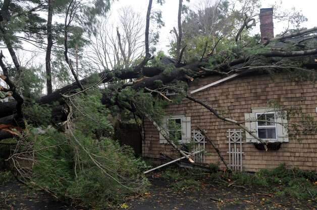 A tree crushed the gatehouse at the Bartlett Arboretum on Brookdale Road which served as a home to newlyweds Brad and Alexandra Nagle after weather from Hurricane Sandy in Stamford, Conn., Oct. 30, 2012. The Nagles were married three weeks ago, their wedding gifts, which included family heirlooms, are still in the house. Photo: Keelin Daly / Stamford Advocate Freelance