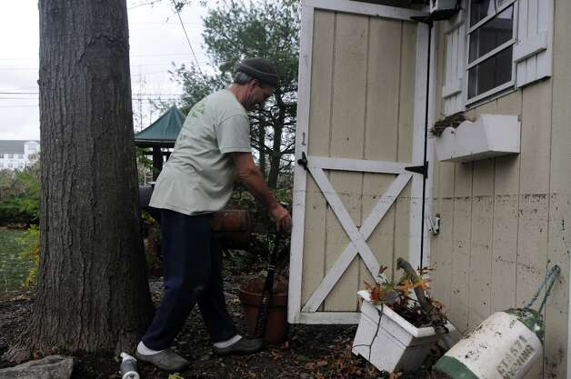 Chris Gerbert assesses the water line left on his Davenport Drive shed after an unusually high tide along with weather from Hurricane Sandy related weather caused unprecedented flooding to the homes and neighborhood in the West side of Stamford, Conn., Oct. 30, 2012. Photo: Keelin Daly / Stamford Advocate Freelance