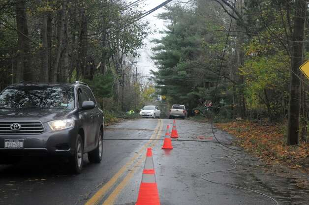 Downed trees and power lines along Scofieldtown Road after Hurricane Sandy related weather in Stamford, Conn., Oct. 30, 2012. Photo: Keelin Daly / Stamford Advocate Freelance